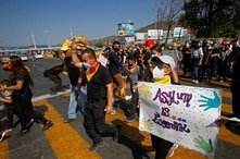 Migrants and human right activists protest against the U.S. and Mexico immigration policies and for the right to seek asylum, at the San Ysidro border crossing port in Tijuana.