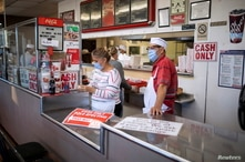 Resturant workers are seen inside one of the city's most popular restaurants amid the coronavirus disease (COVID-19) outbreak,…