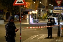 Police officers secure an area after exchanges of gunfire in Vienna, Austria, Nov. 3, 2020.