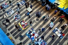 Street vendors, known as 'informal economy', wait for customers in downtown Sao Paulo, 22 April 2004. Unemployment levels in…