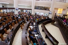 Politicians participate in the first session of the 30th Legislature at the Nicaraguan parliament building in Managua January…