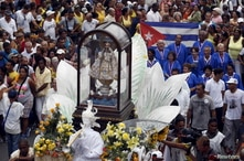 People carry the statue of Our Lady of Charity, the patron saint of Cuba, during the annual procession of Our Lady of Charity,…