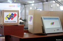 A voting machine is seen as the Venezuela's National Electoral Council presents the technology platform for the upcoming…