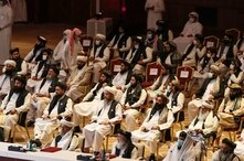 FILE - Members of the Taliban delegation attend the opening session of the peace talks between the Afghan government and the Taliban in the Qatari capital Doha, Sept. 12, 2020.