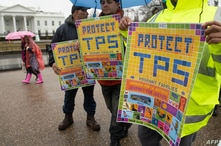 Demonstrators participate in the March For TPS(temporary protected status) Justice as they rally in support of DACA (Deferred…