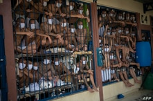 Members of the MS-13 and 18 gangs remain in an overcrowded cell at the Quezaltepeque prison, in Quezaltepeque, El Salvador, on…