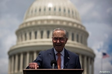 U.S. Senate Minority Leader Chuck Schumer (D-NY) speaks during a news conference to schedule a Senate vote on the Background…