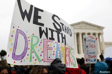 FILE PHOTO: Demonstrators rally outside the U.S. Supreme Court as justices were scheduled to hear oral arguments in the…