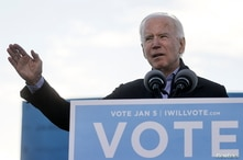 U.S. President-elect Joe Biden speaks as he campaigns on behalf of Democratic U.S. Senate candidates from Georgia Jon Ossoff…