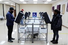 Voters cast their ballots in the U.S. Senate run-off election, at a polling station in Marietta, Georgia, U.S., January 5, 2021…