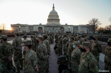 Members of the National Guard gather at the U.S. Capitol as the House of Representatives prepares to begin the voting process…