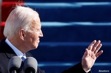 U.S. President Joe Biden gestures during his inauguration as the 46th President of the United States on the West Front of the U…