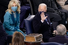 President-elect Joe Biden and his wife Jill Biden are seated next to the Biden family Bible during the 59th Presidential…