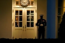 A Marine guard stands at the entrance to the West Wing of the White House, after the U.S. House impeached President Donald Trump in Washington, Wednesday, Jan. 13, 2021. The guard's presence signifies the president is in the Oval Office.