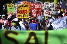 Members of Salvadoran organizations and social movements participate in a protest march against the government of Nayib Bukele…