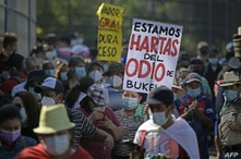 Students from the University of El Salvador hold a demonstration against Salvadorian President Nayib Bukele, a year after the…