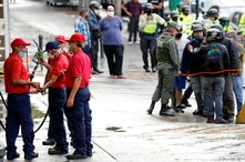 Workers repair a fuel dispenser at a gas station, after Venezuela's government launched new fuel pricing system, in Caracas,…