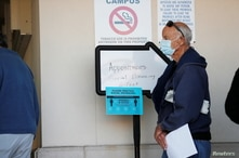 Seniors, who are 65 and over, wait in line at the Department of Health Sarasota COVID-19 Vaccination Clinic in Sarasota,…