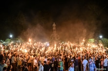 FILE PHOTO: FILE PHOTO: White nationalists participate in a torch-lit march on the grounds of the University of Virginia ahead…