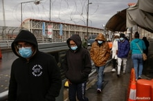 Migrants deported from the U.S. walk towards Mexico at Paso del Norte international border bridge, in this picture taken from…