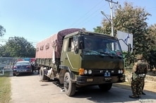An army vehicle is parked outside the parliament members' residence after Myanmar army seized power in a coup, in Naypyitaw,…
