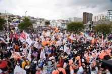 FILE PHOTO: Supporters of Ecuadorean presidential candidate Andres Arauz gather before his closing campaign rally, ahead of the…