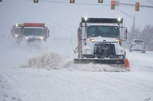 Plows drive down a road during a winter storm Sunday, Feb. 14, 2021, in Oklahoma City. (AP Photo/Sue Ogrocki)