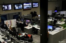 Workers of Current Time, a Russian-language media platform, sit in a newsroom at Radio Free Europe headquarters in Prague,…