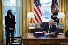 U.S. President Joe Biden signs the American Rescue Plan, a package of economic relief measures to respond to the impact of the…