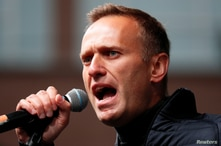 FILE PHOTO: Russian opposition leader Alexei Navalny delivers a speech during a rally to demand the release of jailed…
