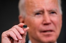 US President Joe Biden holds a semiconductor during his remarks before signing an executive order on the economy in the State Dining Room of the White House on Feb. 24, 2021, in Washington, DC.