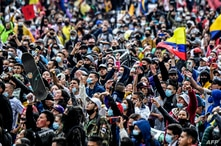 People take part in a protest against a tax reform bill launched by Colombian President Ivan Duque, in Bogota, on April 28,…