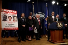 Acting Administrator Uttam Dhillon of the Drug Enforcement Administration (DEA) speaks next to U.S. Attorney General Jeff…