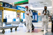 Passengers arrive on a flight from London amid new restrictions to prevent the spread of coronavirus disease (COVID-19) at JFK…