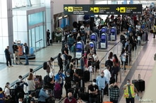 Passengers stand in line at the Tocumen International Airport during the coronavirus disease (COVID-19) outbreak, in Panama…