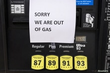 A sign tells drivers that gas pumps are empty as stations from Florida to Virginia began running dry and prices at the pump…
