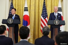 U.S. President Joe Biden and South Korea's President Moon Jae-in hold a joint news conference after a day of meetings at the…