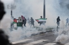 Smoke fills the air during a pro-Palestinian rally called against Israel's bombardment of the Palestinian Gaza Strip, in Paris…