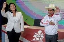 Peru's right-wing candidate Keiko Fujimori and socialist candidate Pedro Castillo wave at the end of their debate ahead of the…
