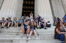Athena Tedder and Norah Benedict, students at Michigan?s Clarkston Junior High School, visit the Lincoln Memorial during their…