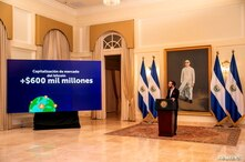 El Salvador's President Nayib Bukele addresses the nation during a live broadcast to speak about his bitcoin legal tender plan,…