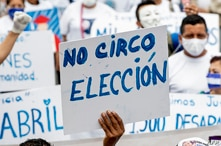 """A Nicaraguan living in Costa Rica displays a placard reading """"No Circus. Election"""" during a demonstration in San Jose to…"""