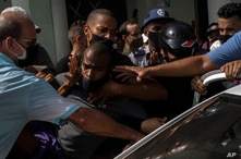 Police detain an anti-government demonstrator during a protest in Havana, Cuba, Sunday July 11, 2021. Hundreds of demonstrators…