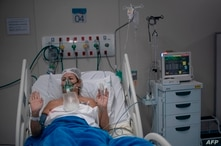 Eliane Lima, 56, prays as she is been treated at the Intensive Care Unit (ICU) ward where patients infected with the novel…