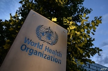 A photo taken in the late hours of August 17, 2020 shows a sign of the World Health Organization (WHO) at their headquarters in…