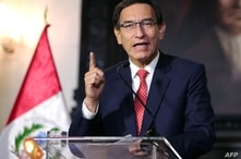 Handout picture released by the Peruvian Presidency showing President Martin Vizcarra giving a televised message to the nation…