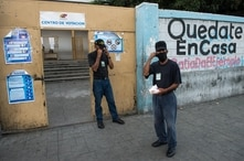 Members of the Bolivarian Militia guard a polling station in a school in Caracas, on December 6, 2020 during the Venezuela's…