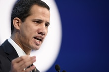 (FILES) In this file photo taken on January 23, 2020 Venezuelan opposition leader Juan Guaido addresses the World Economic…
