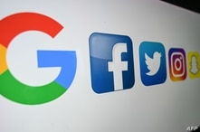 (FILES) In this file photo taken on October 21, 2020 shows the logo of the multinational American Internet technology and…