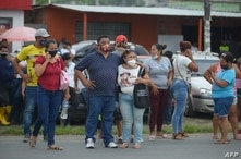 Relatives of the prisoners at the Zone 8 Deprivation of Liberty Center are seen as they wait for news, in Guayaquil, Ecuador,…